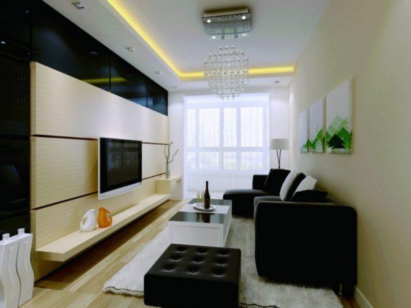 Чёрные диван и пуфик в гостиной