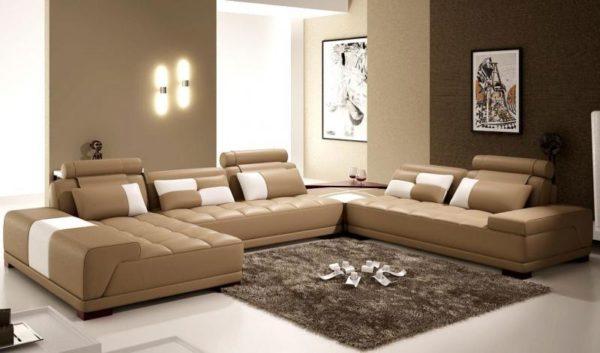 Бежевый коженый диван фото