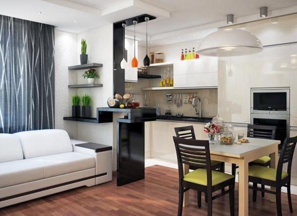 Кухня, диван и обеденная зона