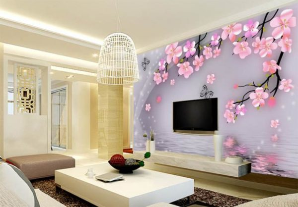 Розовая сакура на стене в гостиной