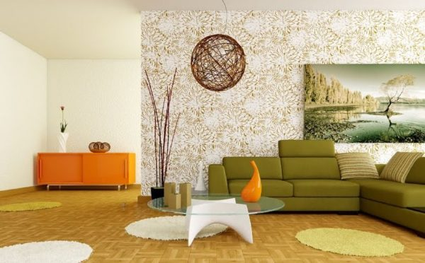 Стеклянный журнальный столик и зелёный диван