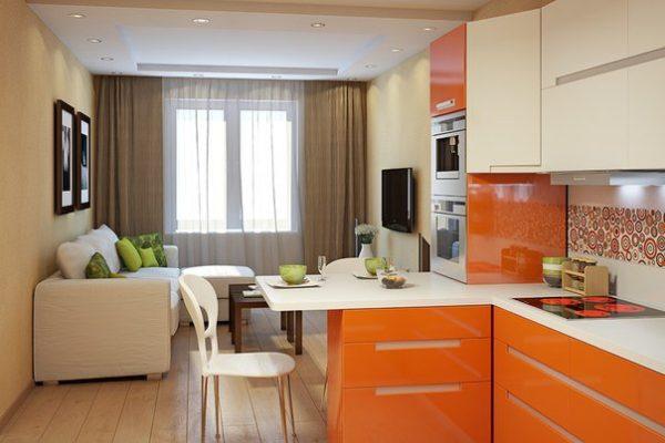 Оранжевый кухонный гарнитур и белый диван