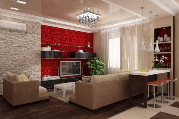 Красные обои в мелкий рисунок и декоративный камень в дизайне гостиной-кухни